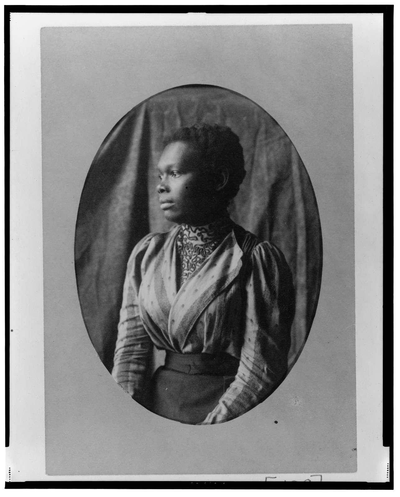 [African American woman, half-length portrait, left profile]